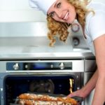 Best Oven Brands- Woman in Kitchen